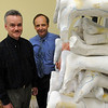 Beverly:<br /> Mike Domenicucci, left, who just recently returned from Haiti, and Keith Cornell who is going to Haiti soon, stand near a rack of plaster casts at Cornell Orthotics.<br /> Photo by Ken Yuszkus/Salem News, Wednesday, May 19, 2010.