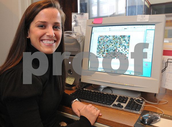 Salem:<br /> Callie Atchue, Endicott College senior, in front of the computer with the postcard on the computer screen that she created as an intern for the Peabody Essex Museum .<br /> Salem News, Monday, November 10, 2008.