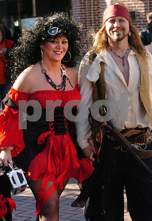 Salem:<br /> Ericka Diehl of Libertyville, Illinois and Rob Andersen of St. Germaine, Wisconsin, walk down Essex Street in costume in the afternoon. Thousands are expected to descend upon Salem tonight for Halloween.<br /> Photo by Ken Yuszkus/Salem News, Friday, October 31, 2008.