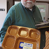 """Danvers:<br /> Alan Hartnett is well known as a local car wash owner, but he's also an avid collector of political memorabilia. He is holding a meal tray that reads """"I ate with Ike"""".<br /> Photo by Ken Yuszkus/Salem News, Wednesday, February 8, 2012."""