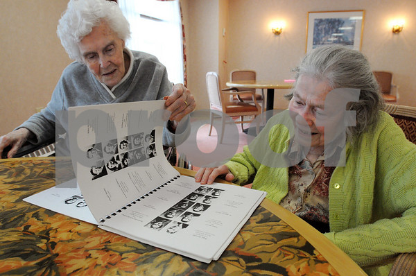 """Beverly:<br /> Evelyn Conant, left, and Mary Mercer, both graduated in 1940 from Beverly High School, look at the """"Senior Memories 1940"""" book . The two women grew up locally in the Great Depression and talk about life then, with real sacrifices. They are residents at the Essex Park Rehabilitation and Nursing Center.<br /> Photo by Ken Yuszkus/Salem News, Wednesday,  February 11, 2009."""