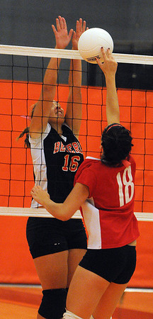 Beverly:<br /> Beverly's Mariah Dodd, left, stops the ball at the net during the Saugus at Beverly girls volleyball game.<br /> Photo by Ken Yuszkus/Salem News, Monday, October 17, 2011.
