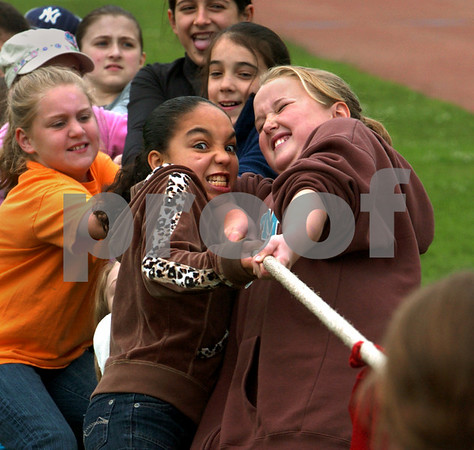Salem:<br /> In front on the left is Tahlia Buckless and on the right in front is Sarah Starion, who are tugging as hard as they can in a tug of war comprised of  fourth grader girls. Witchcraft Heights Elementary School was having a field day at Bertram Field.<br /> Photo by Ken Yuszkus/Salem News, Monday, June 15, 2009.