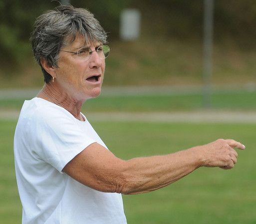 Peabody:<br /> Lorraine Benoit, Peabody High field hockey coach, yells instructions to the players during practice. Coach Benoit is in her 40th, and FINAL, season as the head field hockey coach at Peabody.<br /> Photo by Ken Yuszkus/Salem News, Thursday,  September 9, 2010.