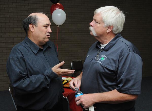 Beverly:<br /> Mike Grenier, left, speaks with Mark Veilleux, Endicott softball coach, at Mike's retirement reception at the Salem News on Thursday evening.<br /> Photo by Ken Yuszkus/Salem News, Thursday, September 8, 2011.