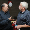 Beverly:<br /> Mike Grenier, left, speaks with Mark Veilleux, Endicott softball coach, at Mike's retirement reception at the Salem News on Thursday evening.<br /> Photo by Ken Yuszkus/Salem News, Thursday, September 8, 2011.