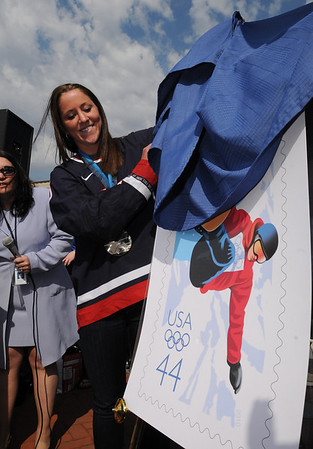 Danvers:<br /> Meghan Duggan, 2010 U.S. women's hockey silver medalist from Danvers, unveils the new olympic stamp in front of the crowd gathered in Danvers Square at the end of the parade in her honor.<br /> Photo by Ken Yuszkus/Salem News, Sunday, March 21, 2010.