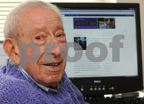 Salem:<br /> Joseph Taylor, 94-years-old, with his own blog page on his computer in the background.<br /> Photo by Ken Yuszkus/Salem News, Tuesday November 10, 2009.
