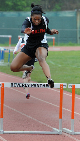 Beverly:<br /> Salem's Jasmine Bryant jumps over her final hurdle and wins her heat of the girls 400 yard hurdles during the Salem at Beverly track meet.<br /> Photo by Ken Yuszkus/Salem News, Tuesday, May 17, 2011.