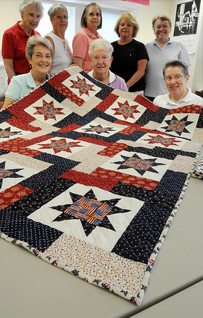 Beverly:<br /> From left, seated, Barbara Blandford, Kathy Paluzzi, Junita Herzeelle, and standing, Jessie Mueller, Patricia Lenares, Sharon McMahon, Pat Femino, and Rorberta Regan,  from the Beverly Senior Center have made a quilt with a pillow case for two women military veterans who lives at the Veterans Hospital in Bedford.<br /> Photo by Ken Yuszkus/Salem News, Wednesday August 4, 2010.