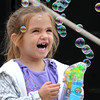 Peabody:<br /> Grace Shannon, 3 1/2, of Beverly, plays with her bubble making toy at the Peabody International Festival.<br /> Photo by Ken Yuszkus/The Salem News, Sunday, September 9, 2012.