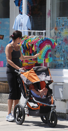 Marblehead:<br /> Kathy Glabicky of Marblehead looks at the shirts on a rack on a Washington Street sidewalk as her son, Jack, 2, waits patiently in his stroller. People strolled downtown Marblehead Monday afternoon during the Marblehead Festival of Arts.<br /> Photo by Ken Yuszkus/Salem News, Monday, July 2,  2012.