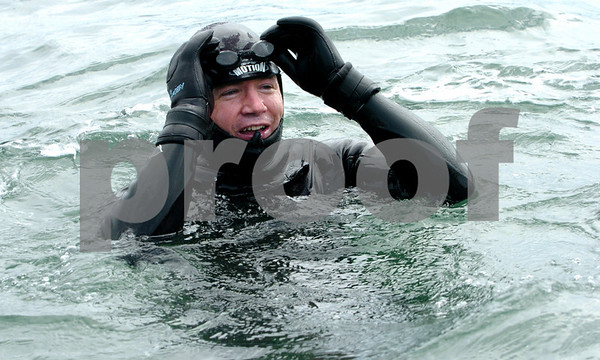 Marblehead:<br /> Chris Swain slips his goggles in place just before starting his swim. The Marblehead man is swimming to Washington D.C. to help environment.<br /> Photo by Ken Yuszkus/Salem News, Wednesday, April 22, 2009.
