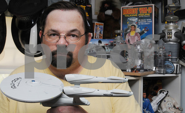 Danvers:<br /> George Corley holds his model of the new starship Enterprise which is part of his large collection of car models, Matchbox cars, and SciFi collectibles.<br /> Photo by Ken Yuszkus/Salem News, Thursday, April 30, 2009.