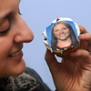 Danvers:<br /> Lynne Sheeley, marketing coordinator at Cakes For Occasions, holds a cupcake made with the likeness of Olympian Meghan Duggan. The cupcakes were made at Cakes For Occasions.<br /> Photo by Ken Yuszkus/Salem News, Wednesday, February 24, 2010.