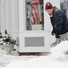 Hamilton:<br /> George Connolly shovels the sidewalk on the corner of Bay Road and Railroad Avenue in Hamilton.<br /> Photo by Ken Yuszkus/Salem News, Tuesday, February 1, 2011.