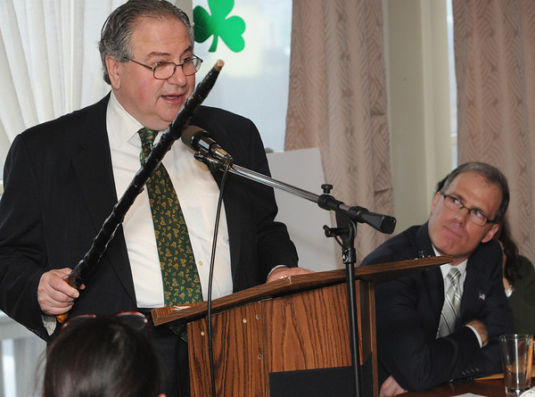 Salem:<br /> House Speaker Robert DeLeo waves a shillelagh during his speech while at the podium as Rep. John Keenan, right, listens. Rep. John Keenan's annual St. Patrick's Day breakfast was held at Finz restaurant on Friday morning.<br /> Photo by Ken Yuszkus/Salem News, Friday, March 11, 2011.