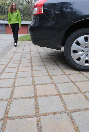Ipswich:<br /> Cynthia Ingelfinger, of the Ipswich River Watershed Association, walks by the permeable pavement located at the Ipswich River Watershed Association. <br /> Photo by Ken Yuszkus/Salem News, Thursday, May 12, 2011.
