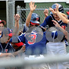 Beverly:<br /> Peabody West's Austin Batchelor gets congratulated by his team after his home run during the State Little League championship game of Peabody West vs Newton Central at Harry Ball Field.<br /> Photo by Ken Yuszkus/Salem News, Monday, August 3, 2009.