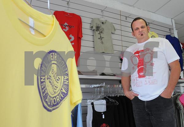 Salem:<br /> Scott Lanes, founder of Peace Through Violence fashion line, at his buisness.<br /> Photo by Ken Yuszkus/Salem News, Saturday, September 12, 2009.