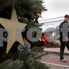 Danvers:<br /> Dick Caldarone walks by the decorated Christmas tree on the corner of Conant and Maple Street. The tree was cut down on his street, Carolyn Drive<br /> , in Danvers and placed in the center of town.<br /> Photo by Ken Yuszkus/Salem News, Tuesday December 16, 2008.