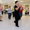 Danvers:<br /> Tina LaFlam, center, line dance instructor, leads the group during a line dance at the Danvers Council on Aging.<br /> Photo by Ken Yuszkus/Salem News, Wednesday, June 15, 2011.