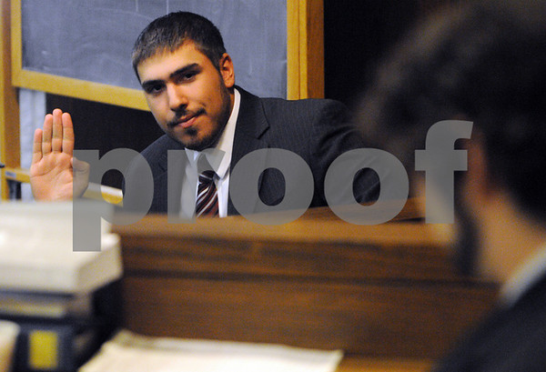 Peabody:<br /> Anthony Arduino acts as a witness on the stand during the mock trial at Peabody District Court. Peabody High School students used the courtroom on thursday morning to conduct the trial.<br /> Photo by Ken Yuszkus/Salem News, Thursday, April 30, 2009.
