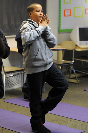 Salem:<br /> Antonio Rosario performs a yoga exercise at the Collins Middle School. Students in Sarah Mason's Learning Skills Classroom did yoga in class.<br /> Photo by Ken Yuszkus/Salem,  News, Monday,  December 20, 2010.