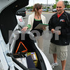 Beverly:<br /> Andrea Fox, left, shows her car's trunk to Matt Herring, as Matt discusses the relationship of an over stuffed car trunk and it's effect on gas consumption. He teaches super commuter driving classes.<br /> Photo by Ken Yuszkus/Salem News, Thursday, June 18, 2009.