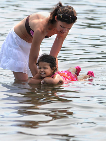 Beverly:<br /> Traci Pacheco holds her daughter, Damani, 2, of Danvers, while she attempts to swim at Danes Street Beach. The hot weather sent people into the water to cool off.<br /> Photo by Ken Yuszkus/Salem News, Monday, July 4, 2011.