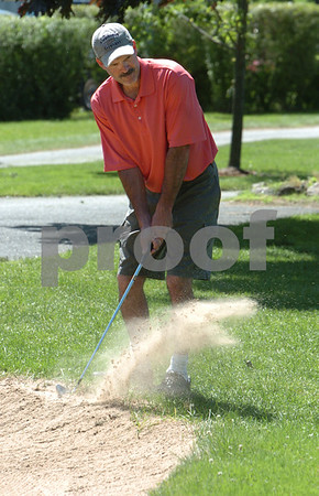 Beverly:<br /> Ken Richardson hits out of the 18th sand trap during the Beverly Hockey Alumni Golf Tournament at Beverly Golf & Tennis Club.<br /> Photo by Ken Yuszkus/Salem News, Monday, July 13, 2009.