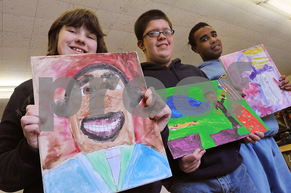 Danvers:<br /> From left, Pam Hills, Justin Killam, and Nathan Barclay, all seniors at Danvers High School, stand with their artwork which is for a special youth MLK celebration on Monday.<br /> Photo by Ken Yuszkus/Salem News, Thursday,  January 15, 2009.