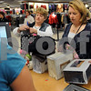 Danvers:<br /> Marilyn Deschenes, left, and Debbie Petroccione. both of Beverly, place the bargins that they found, onto the check out counter at Kohl's department store. Black Friday sent shoppers swarming the stores looking for bargains.<br /> Photo by Ken Yuszkus/Salem News, Friday November 28, 2008.
