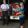 Peabody:<br /> Peabody deputy fire chief Joe Daly speaks with student Justin Dicciso after just accepting a $250 dollar donation received from Justin who represents the Northshore Education Consortium. The school raised money for the James Rice foundation, in memory of the Peabody firefighter who lost his life in December while fighting a fire.<br /> Photo by Ken Yuszkus/Salem News, Friday, June 8, 2012.