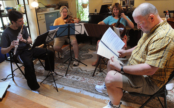 Belmont:<br /> From left, Orlando Cela, flute, Maria Benotti, violin, Sarah Freiberg, cello, John Wallace, composer, and Neil Fairbairn, bassoon, hidden, all with Music at Eden's Edge, practice John Wallace's musical tribute to the North Shore while at a home in Belmont.<br /> Photo by Ken Yuszkus/Salem News, Tuesday, June 15, 2010.