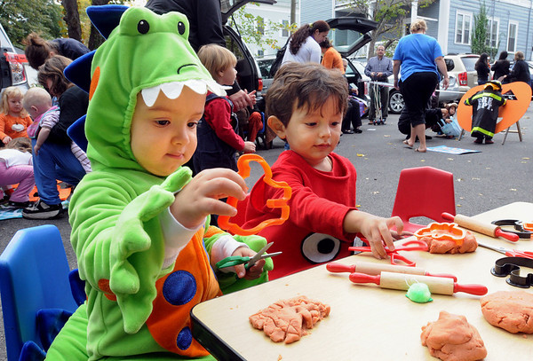 Salem:<br /> Jacob Almonte, 2, left, of Salem, and Jayden Alejandro, 2, of Chelsea, use cookie cutters on the pumpkin scented Play-Doh at the North Shore Infant and Toddler Program. Cerebral Palsy Association. of Eastern Mass had a Halloween celebration for children in its Salem program on Wednesday.<br /> Photo by Ken Yuszkus/Salem News, Wednesday, October 12, 2011.