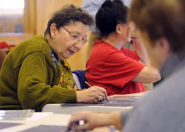 Peabody:<br /> Charlotte Savage works on her pastel interpretation of Vincent Van Gogh's Starry Night during the expressive panel painting workshop for adults at South Branch Library.<br /> Photo by Ken Yuszkus/Salem News,  Monday,  November 29, 2010.
