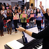Hamilton:<br /> Abby Frost, choral dirctor, leads students during practice for the Hamilton-Wenham Regional High School's 18th annual Hearts and Flowers Cabaret which will be Wednesday, February 8.<br /> Photo by Ken Yuszkus/Salem News, Tuesday, January 31, 2012.
