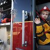 Beverly:<br /> Colin Andrew waves while inside a fire truck. He was picked up by the Beverly Fire Department at the North Beverly School for a ride home. Colin Andrew's aunt, Lisa Balentine, won the ride at an auction to benefit St. Mary's School in Beverly.<br /> Photo by Ken Yuszkus/Salem News, Friday, December 11, 2009.