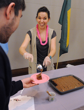 "Salem:<br /> Samantha Cepican, Salem State University senior, serves up a piece of cake with the latin version of caramel frosting at the Latin Culture table during the ""Eight Cultures One Fight"" fundraiser for American Cancer Society at the Veteran's Hall in Ellison Campus Center at Salem State University.  The eight cultures represent the 1 in 8 women that are diagnosed with breast cancer. There was food dishes from around the world, and survivors shared their stories. The fundraiser was put on by the Public Relations Student Society of America and the Multicultural Student Association.<br /> Photo by Ken Yuszkus/Salem News, Tuesday,  October 26, 2010."