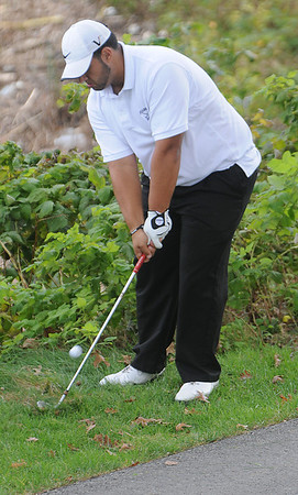 Salem:<br /> Athan Goulos, of Peabody, shoots for the 6th hole during the Northeastern Conference Golf Open at Kernwood Country Club. <br /> Photo by Ken Yuszkus/Salem News, Tuesday, October 18, 2011.