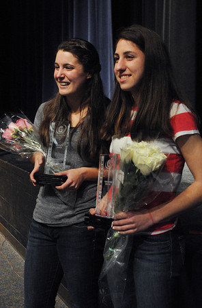 Peabody:<br /> Hayley Dowd , left, and Catarina Rocha received Gatorade State Athletes of the Year trophies and banners at the Peabody Veterans Memorial High School on Wednesday afternoon.<br /> Photo by Ken Yuszkus/Salem News, Wednesday,  March 14, 2012.