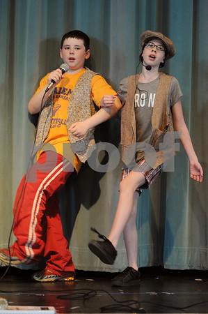 Salem:<br /> Jonathon Philbin, left, as Mr. Bucket, and Jeanette Abbene, as Charlie, sing and dance together on stage during dress rehearsal. The Saltonstall middle school students are performing Willy Wonka the musical on Wednesday, Thursday, and Friday.<br /> Photo by Ken Yuszkus/Salem News, Tuesday, April 28, 2009.