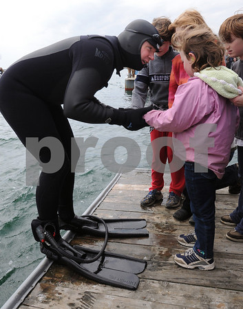 Marblehead:<br /> Chris Swain holds the hand of his sobbing daughter Celilo Bauman-Swain, 5, to comfort her just before he jumps into the ocean to start his swim. The Marblehead man is swimming to Washington D.C. to help environment.<br /> Photo by Ken Yuszkus/Salem News, Wednesday, April 22, 2009.