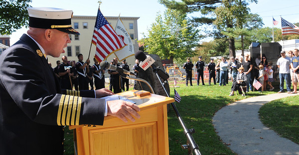 Marblehead:<br /> Marblehead Fire Chief Jason Gilliland speaks during the 9/11 ceremony at Memorial Park on Sunday.<br /> Photo by Ken Yuszkus/Salem News, Sunday, September 11, 2011.