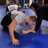 Peaody:<br /> D.J. Henrick, left, and George Nash, Peabody High School wrestlers practice in the school's cafeteria.<br /> Photo by Ken Yuszkus/Salem News, Thursday,  December 9, 2010.