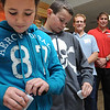 "Beverly:<br /> From left, Julia Pitman, Seth Emelian, both Beverly North Elementary School 5th gaders, examine their pedometers as Chandler Jones, health and physical education teacher, Beverly North Elementary School, and Andrew Walker, director of health and wellness at the Greater Beverly YMCA, stand in the background. The Greater Beverly YMCA is again collaborating with the Beverly Public Schools to implement the ""Step it Up"" program this October, encouraging all 5th graders to get daily physical activity. Over the course four weeks, over 400 5th graders from every public school in Beverly will track their steps with pedometers. Their goal is to be the most active school in the city.<br />  Photo by Ken Yuszkus/Salem News, Monday, October 3, 2011."
