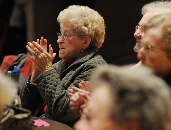 Salem:<br /> Nancy Delivorias of Peabody applauds the Salem High School's WitchPitch, who sang for the AARP Chapter 2454 meeting in the Salem High School auditorium on Friday afternoon.<br /> Photo by Ken Yuszkus/Salem News, Friday, January 7, 2011.