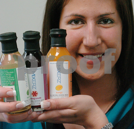 Beverly:<br /> The company Mixerz, which makes all natural cocktail mixers, was chosen to have the products placed into a 1,200 prestigius gift bags at 2008 International Emmy Awards on Nov. 22 and 23. Christina Pesente, marketing coordinator, displays 3 of the 8 different types of mixers, which were placed into the gift bags..<br /> Photo by Ken Yuszkus/Salem News, Thursday November 6, 2008.