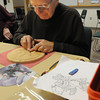 Danvers:<br /> Phil Tkachuk, of Peabody, carves away at his project during the wood carving class at the Danvers Council on Aging.<br /> Photo by Ken Yuszkus/Salem News, Friday, January 13, 2012.